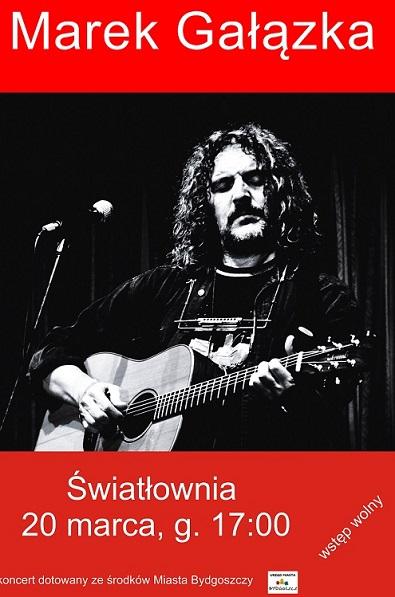 Plakat . U góry napis Marek Gałązka. W środku zdjęcie długowłosego mężczynygrającego na gitarze.