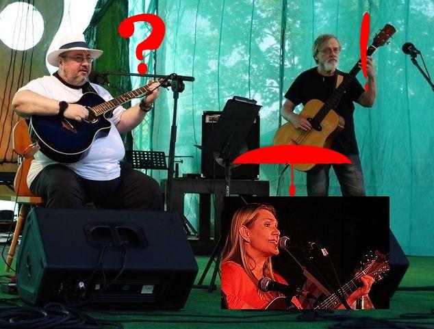 Dwóch gitarzystów i wokalistka na scenie