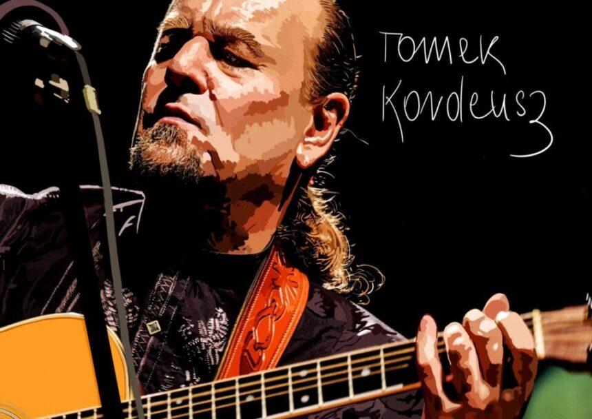 mężczyzna w średnim wieku z gitarą